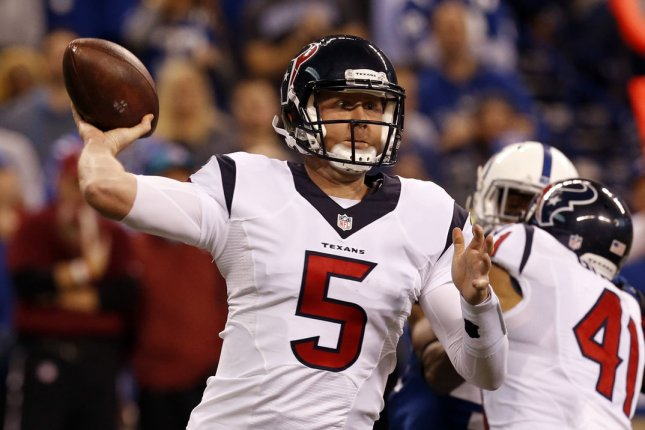 Houston Texans quarterback Brandon Weeden (5) throws under pressure from the Indianapolis Colts defense during the second half of play on December 20, 2015 at Lucas Oil Stadium in Indianapolis, Indiana. File photo by John Sommers II/UPI