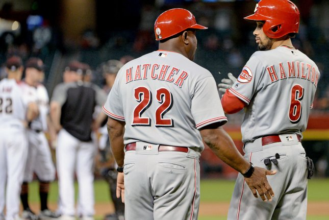 Cincinnati Reds' Billy Hamilton (R) talks with third base coach Billy Hatcher as the Arizona Diamondbacks meet on the mound in the background in the eighth inning on May 30 at Chase Field in Phoenix. Photo by Art Foxall/UPI