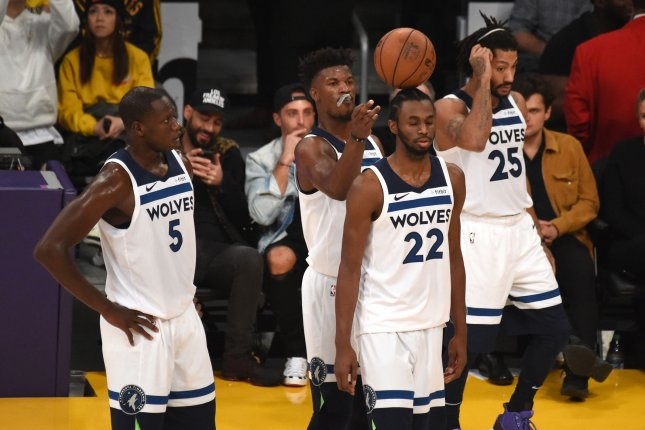 Minnesota Timberwolves forward Jimmy Butler balances the ball on teammate Andrew Wiggins (22) during a timeout against the Los Angeles Lakers on November 7, 2018 at Staples Center in Los Angeles. Photo by Jon SooHoo/UPI
