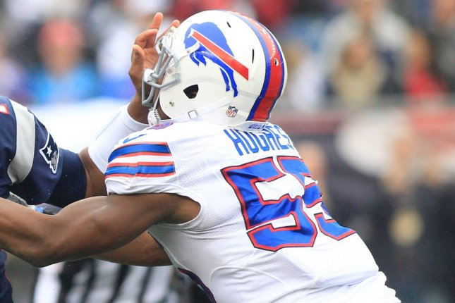 Buffalo Bills linebacker Jerry Hughes attempts to sack the quarterback during a game against the New England Patriots in 2016. Photo by Matthew Healey/UPI