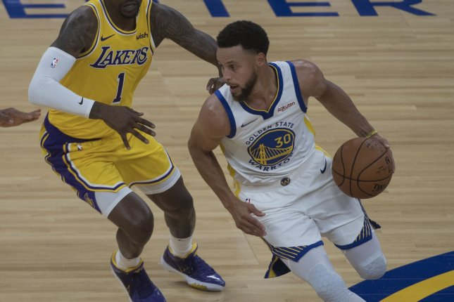 Golden State Warriors guard Stephen Curry suffered a broken left hand during Wednesday's loss to the Phoenix Suns. Photo by Terry Schmitt/UPI