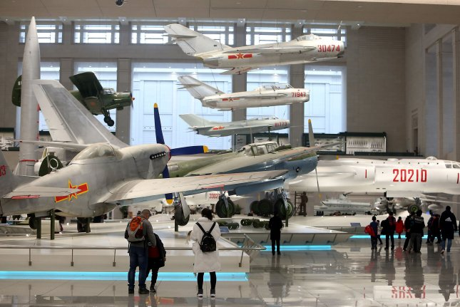 Visitors observe aircraft at China's Military Museum in Beijing. A study released on Monday indicates that China is the world's second-largest arms producer, ahead of Russia and behind only the United States. Photo by Stephen Shaver/UPI