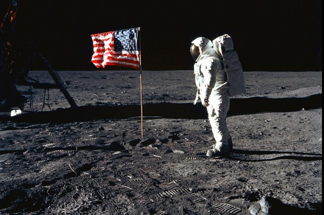 Astronaut Edwin E. Aldrin, Jr., lunar module pilot of the first lunar landing mission, poses for a photograph beside the deployed United States flag during Apollo 11 Extravehicular Activity (EVA) on the lunar surface on July 20, 1969. (UPI Photo/NASA/FILES)