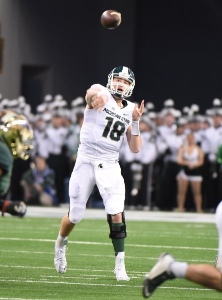 Michigan State's Connor Cook throws against Baylor Bear's during the first half of the Cotton Bowl in AT&T Stadium, Arlington, Texas on January 1, 2015. Ian Halperin/UPI