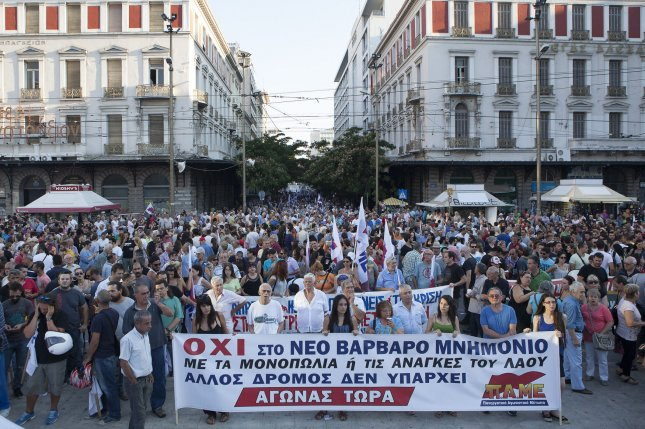 Greek citizens protest the latest round of austerity measures. Researchers suggest harsh spending cuts have encouraged suicides in Greece, Spain, Portugal, Italy and Ireland. Photo by Dimitris Michalakis/UPI