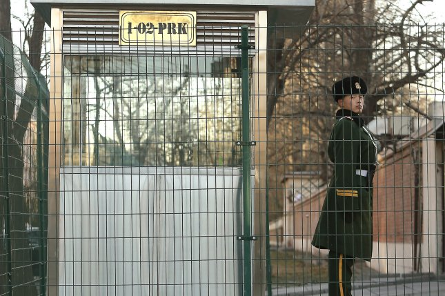 A Chinese soldier stands guard outside the North Korean embassy in Beijing. North Korea denied any ties to a cyberattack that Seoul says was launched from an IP address in Shenyang, China. File Photo by Stephen Shaver/UPI