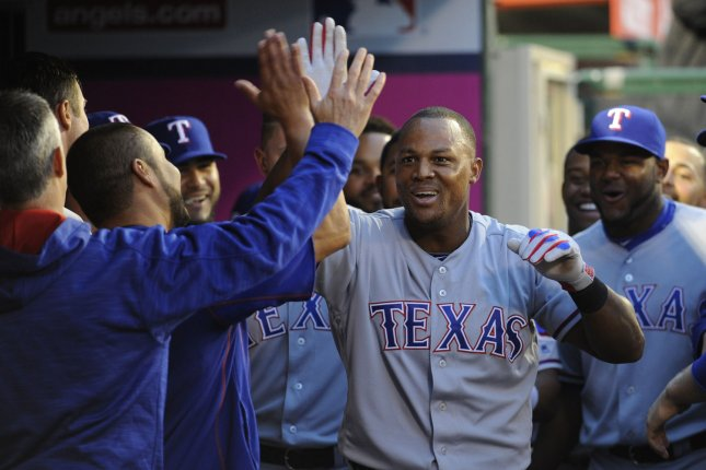 Texas Rangers' Adrian Beltre is congratulated by teammates after returning to the dugout. File photo by Lori Shepler/UPI