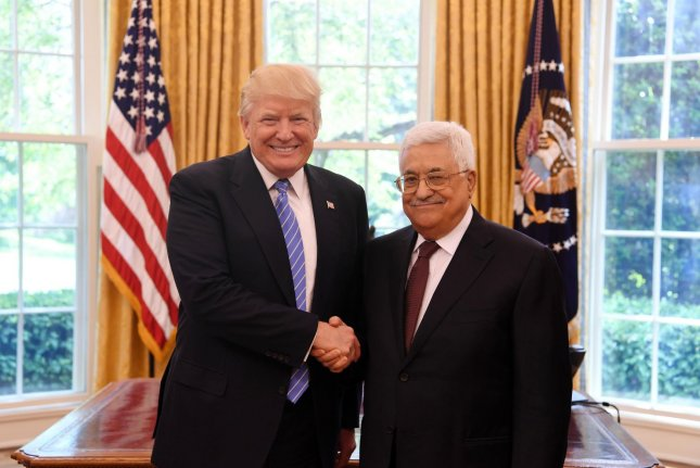 President Donald Trump poses for a handshake picture with President Mahmoud Abbas of the Palestinian Authority in the Oval Office of the White House on May 3. The PA has officially suspended contact with the United States after the Palestine Liberation Organization's office was closed in Washington. Photo by Thaer Ghanaim/UPI