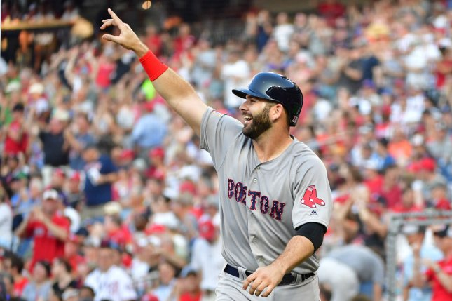 Boston Red Sox first baseman Mitch Moreland (18) celebrates after scoring off of a three-run double hit by pitcher Rick Porcello against the Washington Nationals in the second inning on July 2 at Nationals Park in Washington, D.C. Photo by Kevin Dietsch/UPI
