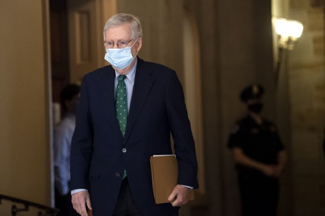 Senate Majority Leader Mitch McConnell, R-Ky., walks to the Senate chambers as the Senate reconvenes following an extended recess due to the coronavirus pandemic. Photo by Kevin Dietsch/UPI