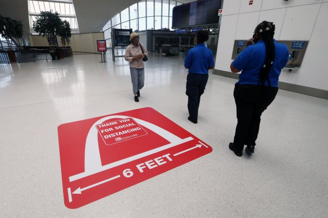 A distancing sticker on the floor greets visitors to St. Louis-Lambert International Airport in St. Louis, Mo., on June 18. Photo by Bill Greenblatt/UPI