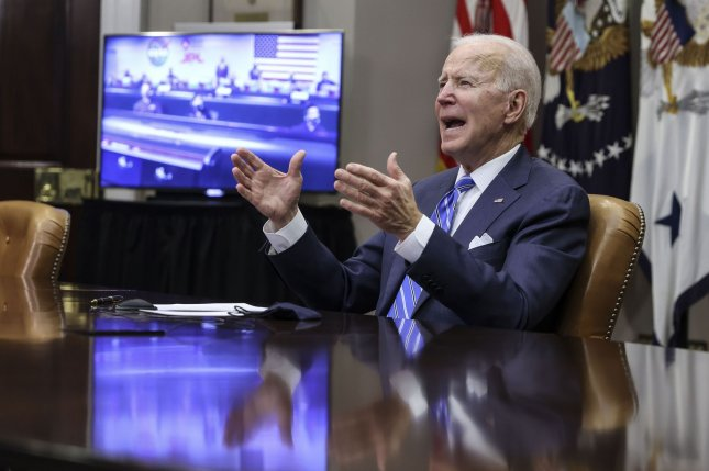 President Joe Biden congratulates the NASA Jet Propulsion Laboratory team on the Mars rover Perseverance's Feb. 8 landing, during a virtual call from the Roosevelt Room of the White House on Thursday. Pool Photo by Oliver Contreras/UPI