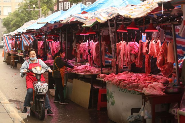 Pork is sold at a market in Wuhan, China, on November 1, 2020. A wet market in Wuhan was identified as the epicenter of the Covid-19 pandemic outbreak, but a WHO draft report suggests livestock farms could have been the original source. File Photo by Stephen Shaver/UPI