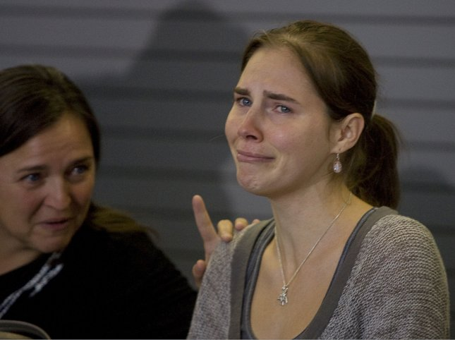 Amanda Knox (R) is comforted by her mother, Edda Knox, during a news conference in Seattle Oct. 4, 2011. UPI Photo/Jim Bryant