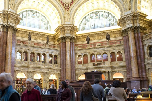 People tour the main reading room during an open house at the Library of Congress in Washington,Oct. 10, 2011. (The Library of Congress was established on April 24, 1800.) File Photo by Kevin Dietsch/UPI