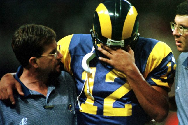 St. Louis Rams quarterback Tony Banks rubs his head as he is helped to the locker room by a team trainer, after being hit hard by the Carolina Panthers defense, in the second quarter, November 23, 1997. Banks remained out of the game with a mild concussion. New research is helping scientists why rest is important for recovery in the wake of a concussion. Photo by UPI/rw/Bill Greenblatt