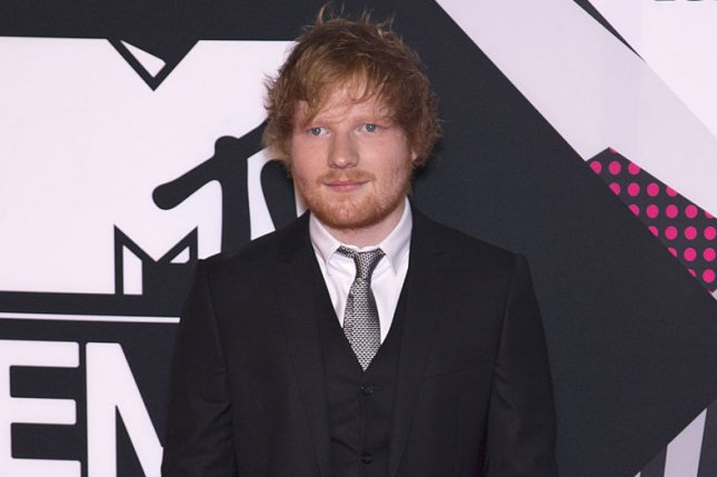 Ed Sheeran arrives at the MTV Europe Music Awards on October 25, 2015. In a new interview, Sheeran shares a story of how he once hit Justin Bieber with a golf club. File Photo by David Silpa/UPI