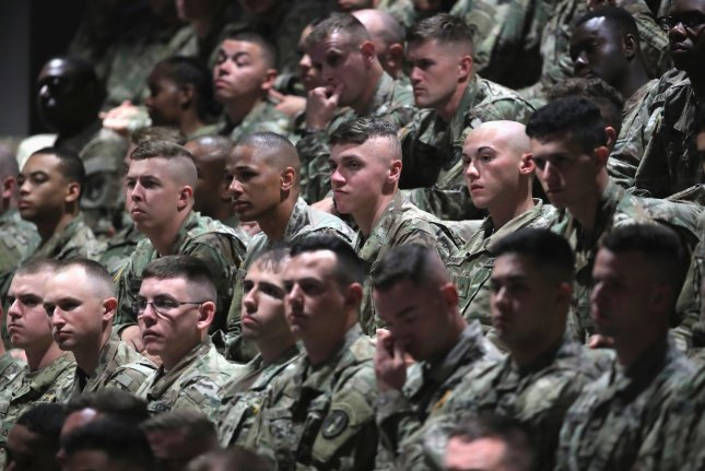 U.S. military personnel listen to President Donald Trump deliver remarks on America's involvement in Afghanistan at the Fort Myer military base on August 21 in Arlington, Va. On Monday, Defense Secretary James Mattis said the United States would send an additional 3,000 troops to Afghanistan. File Pool Photo by Mark Wilson/UPI
