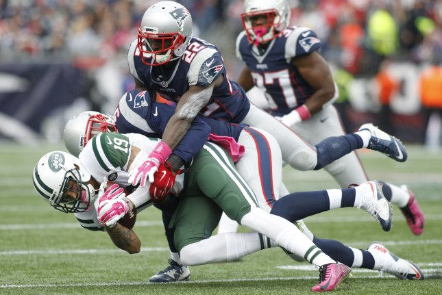 New York Jets wide receiver Devin Smith (19) is tackled by ex-New England Patriots linebacker Jamie Collins (91) and former Patriots defensive back Justin Coleman (22) in the third quarter on October 25, 2015 at Gillette Stadium in Foxborough, Massachusetts. File photo by Matthew Healey/UPI