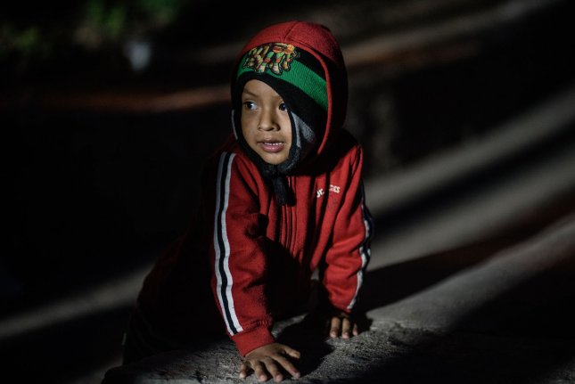 A child migrant is seen near the border at Playas de Tijuana, Mexico, on December 9, 2018. File Photo by Ariana Drehsler/UPI