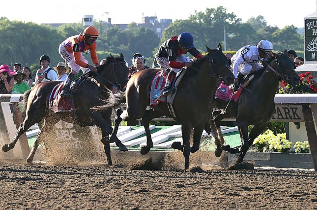 Tonality, Joel Rosario up, (center) wins the 146th Belmont Stakes Belmont Park in Elmont, New York, June 7, 2014. He is flanked by Medal Count (left) ridden by Robby Albarado, and Commissioner, ridden by Javier Castellano (right) UPI/Mark Abraham