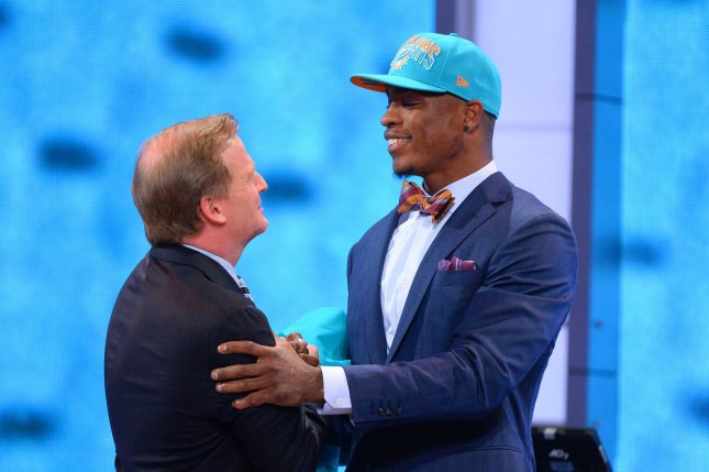 Dion Jordan, former defensive end from Oregon, greets NFL Commissioner Roger Goodell after the Miami Dolphins select him as the #3 overall pick in the 2013 NFL Draft at Radio City Music Hall in New York City on April 25, 2013. UPI /Rich Kane