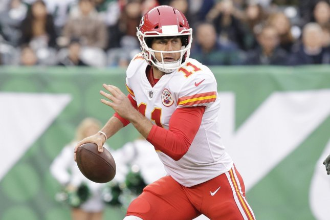 Former Kansas City Chiefs and current Washington Redskins quarterback Alex Smith rolls out of the pocket in the first half against the New York Jets in Week 13 of the NFL season on December 3, 2017 at MetLife Stadium in East Rutherford, New Jersey. Photo by John Angelillo/UPI