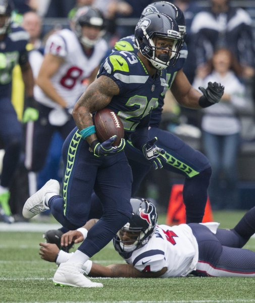 Seattle Seahawks free safety Earl Thomas (29) returns an interception 59 yards for touchdown against the Houston Texans during their game last October. Photo by Jim Bryant/UPI