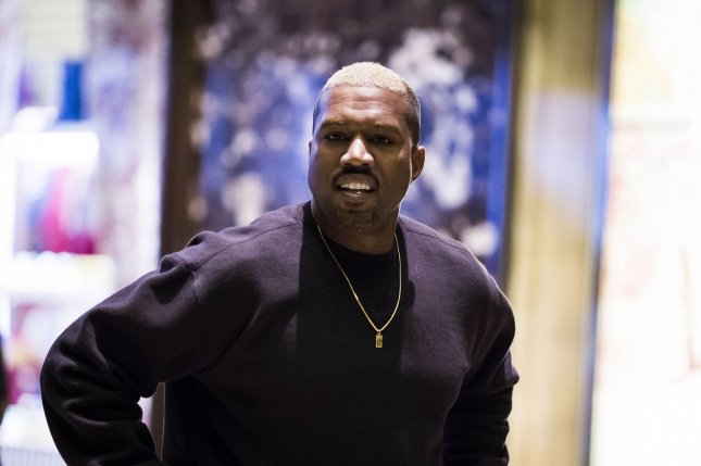Kanye West walks through the lobby of Trump Tower in New York City on December 13, 2016. The rapper turns 42 on June 8. File Photo by John Taggart/UPI
