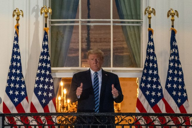 President Donald Trump stands on the Truman Balcony at the White House in Washington, D.C., after returning from Walter Reed National Military Medical Center, where he spent several days undergoing treatment for COVID-19. File Photo by Ken Cedeno/UPI
