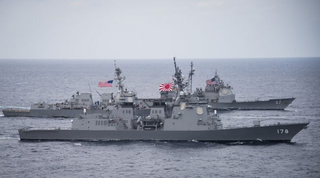 U.S. Navy's Adm. Mike Gilday and Japan Maritime Self-Defense Forces Ad. Hiroshi Yamamura cited military exercises, including the 2017 pictured exercise with the U.S. Navy's USS Wayne E. Meyer and USS Lake Champlain and Japan Maritime Self-Defense Force destroyer JS Ashigara, as essential to the two nations' partnership during a videoconference this week. File Photo by MC2 Z.A. Landers/U.S. Navy/UPI