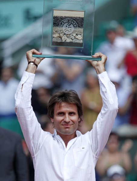Recently-retired Frenchman Fabrice Santoro receives an award for his 20 years of competing in the French Open at Roland Garros in Paris on June 1, 2009. (UPI Photo/ David Silpa)