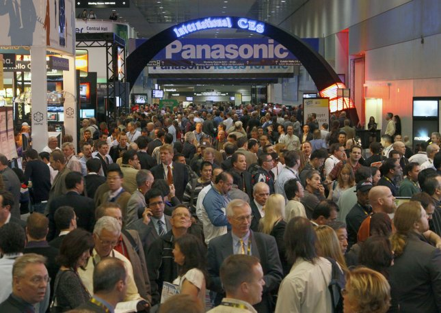 Industry professionals visit exhibitors in the Grand Lobby of the Las Vegas Convention Center at the 2010 International Consumer Electronics Show (CES) in Las Vegas on January 7, 2010. Microsoft said it will no longer keynote the trade show after the 2012 CES. UPI/CES Handout