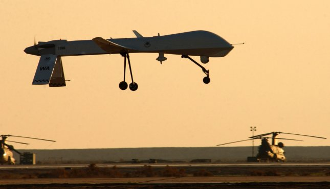 A RQ-1 Predator from the 46th Expeditionary Reconnaissance Squadron lands at Tallil Air Base, Iraq on Jan. 20, 2004. The Predator is a remotely piloted vehicle that provides real-time surveillance imagery in support of Operation Iraqi Freedom. (UPI Photo/Suzanne M. Jenkins/AFIE)