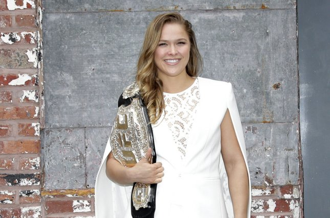 UFC's Ronda Rousey says she and Floyd Mayweather would probably never fight unless they ended up dating. When that answer sounds innocent enough, it's really an allusion to the boxer's history of domestic abuse. Rousey will appear in the upcoming 'Entourage' film as herself. Photo by John Angelillo/UPI