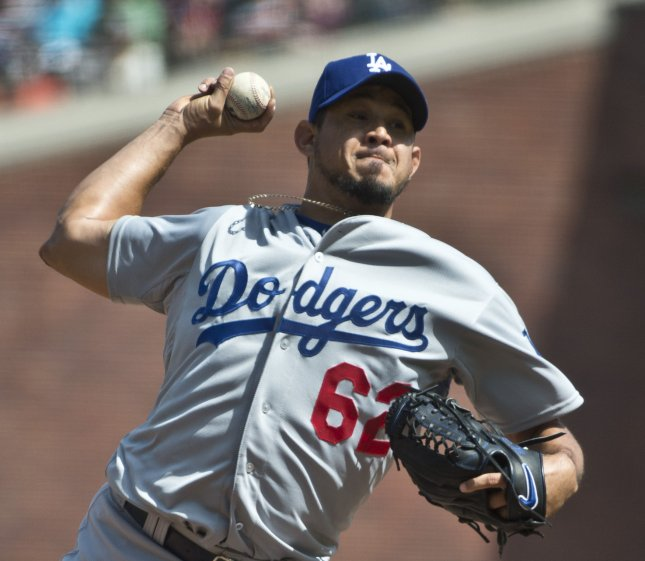 Los Angeles Dodgers Joel Peralta throws in relief against the San Francisco Giants in the eighth inning at AT&T Park in San Francisco on April 23, 2015. The Giants defeated the Dodgers 3-2 in 10 innings. Photo by Terry Schmitt/UPI