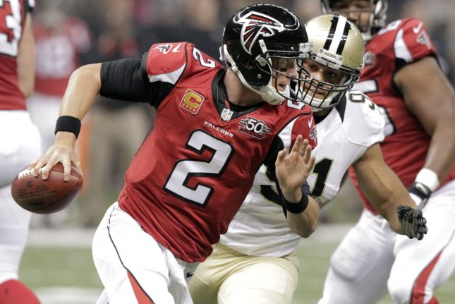 Atlanta Falcons quarterback Matt Ryan (2) is sacked for an 11 yard loss by New Orleans Saints outside linebacker Kasim Edebali (91) during the first quarter at the Mercedes-Benz Superdome in New Orleans October 15, 2015. Photo by AJ Sisco/UPI