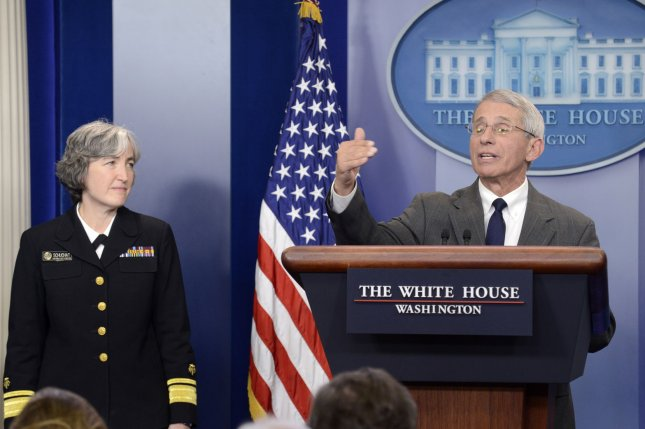 Dr. Anthony Fauci (R), director of the National Institutes of Health/National Institute of Allergy and Infectious Diseases, makes remarks as Dr. Anne Schuchat, principal deputy director of the Centers for Disease Control and Prevention, listens during a press briefing on efforts to combat Zika at the White House in February. File Photo by Mike Theiler/UPI