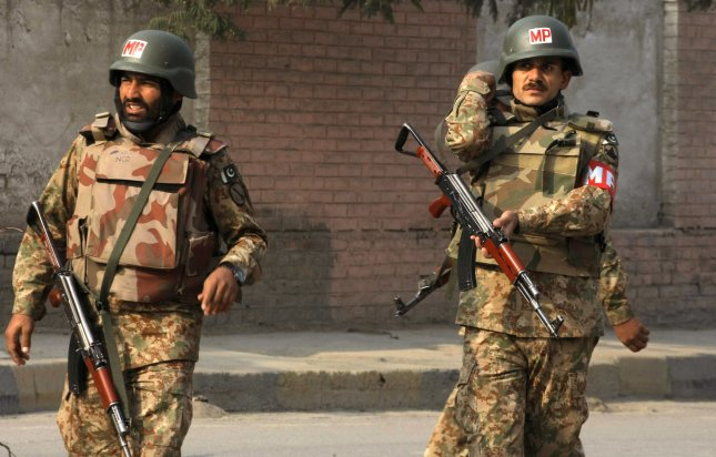 Pakistani soldiers take a position near the site of an attack by Taliban gunmen on a school in Peshawar on December 16, 2014. File Photo by Sajjad Ali Queshi/UPI