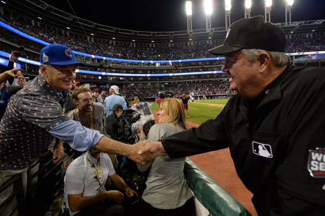 Actor Bill Murray (L) greets and exchanges a joke with umpire Joe West during the seventh inning of the Chicago Cubs and Cleveland Indians World Series game 7 at Progressive Field in Cleveland, Ohio, on November 2, 2016. Photo by Pat Benic/UPI
