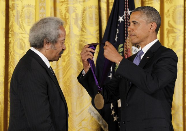 President Barack Obama awards the 2012 National Medal of Arts to composer, producer, and performer Allen Toussaint during a ceremony in the East Room of the White House in Washington, July 10, 2013. UPI/Molly Riley