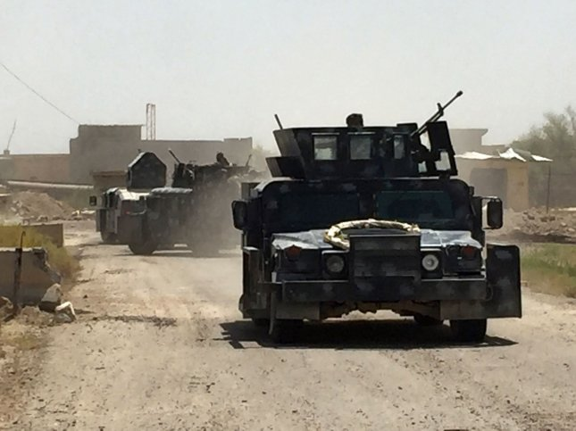 Vehicles of the Iraqi forces are seen in Fallujah's southern Shuhada neighborhood during an operation to retake areas from the Islamic State (IS) group on June 15, 2016.On late Saturday, a suicide bomber set off an explosion near Baghdad that killed at least 78 and injured more than 160. Photo by Abbas Mohammed /UPI