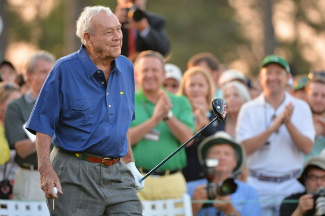 Arnold Palmer, seen in this April 9, 2015 file photo hitting the honorary tee shot to start the 2015 Masters, died today, September 25, 2016, at the age of 87. The seven-time major winner was known as the king of golf and given credit for bringing the sport to the masses. File photo by Kevin Dietsch/UPI