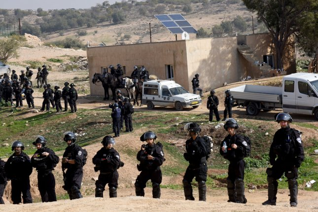 Israeli police special forces stand guard after demolishing houses in the unrecognized Bedouin village of Umm al-Haran, in the Negev, near the southern city of Beer Sheva, Israel on Wednesday. Violent clashes resulted in the death of a police and of a local resident, with protesters calling for an investigation into what caused the fatal encounter. Photo by Debbie Hill/UPI