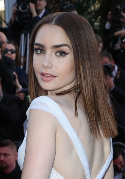 Lily Collins arrives on the red carpet before the screening of the film Okja during the 70th annual Cannes International Film Festival on May 19. Photo by David Silpa/UPI