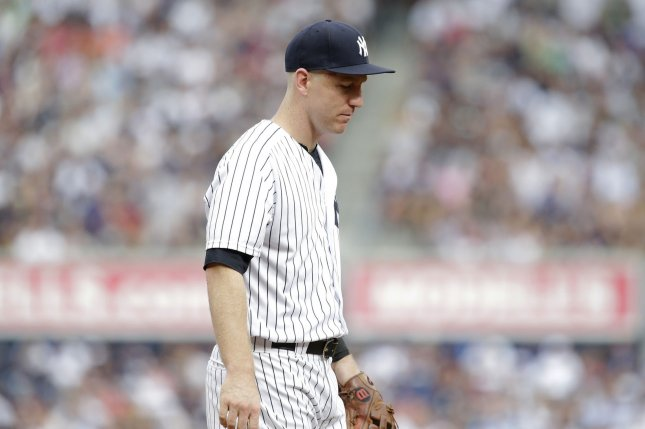 New York Yankees Todd Frazier reacts after making an error in the 3rd inning against the Boston Red Sox at Yankee Stadium in New York City on August 12, 2017. Photo by John Angelillo/UPI