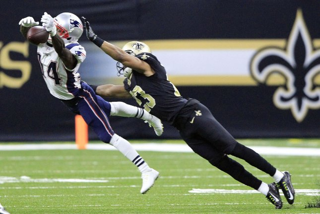 New England Patriots wide receiver Brandin Cooks (14) has the ball knocked away by New Orleans Saints cornerback Marshon Lattimore (23) during the first quarter on September 17 at the Mercedes-Benz Superdome in New Orleans, La. Photo by AJ Sisco/UPI