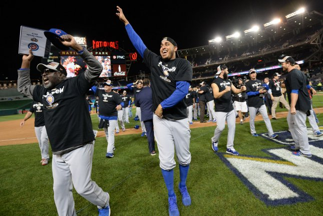 The Chicago Cubs celebrate their win over the Washington Nationals during National League Division Series game 5 at Nationals Park in Washington, D.C. on October 13, 2017. Chicago held off Washington 9-8 to advance to the National League Championship Series against the Los Angeles Dodgers. Photo by Kevin Dietsch/UPI