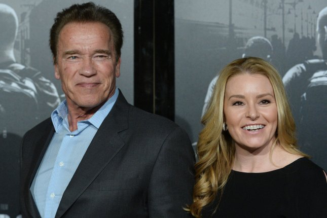 Arnold Schwarzenegger (L), pictured here with Heather Milligan, will star in a film version of Kung Fury. File Photo by Jim Ruymen/UPI