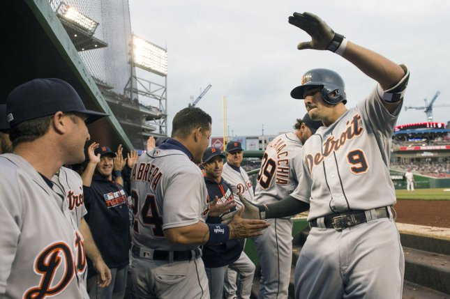 Detroit Tigers third baseman Nick Castellanos (9) is congratulated by teammates after Castellanos hit a two-run home run in the first inning against the Washington Nationals on May 9, 2016 at Nationals Park in Washington, D.C. File photo by Kevin Dietsch/UPI
